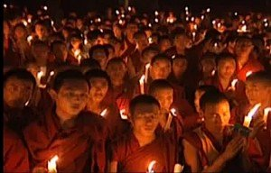 Buddha Weekly 0Monks chanting mantra by candlelight buddhist practice
