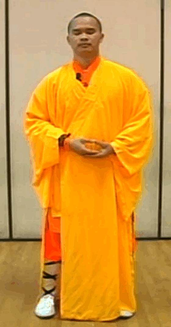 Shaolin Monk Demonstrates One Correct Posture For Buddhist Standing Meditation