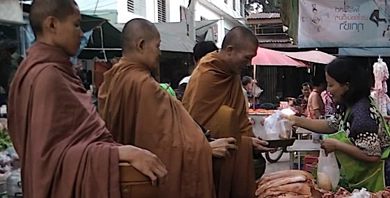 Buddha Weekly 2Monks Buddhist receiving alms gives opportunity for lay believers to practice generosity