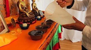 Buddha Weekly 4Tibetan water offering fill bowls left to right