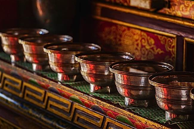 Offerings (Tibetan Water Offering Bowls) in Lamayuru gompa (Tibetan Buddhist monastery). Ladadkh, India.