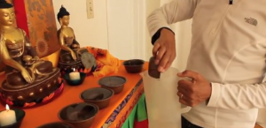 Tibetan water offering bowl empty right to left