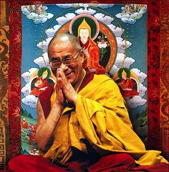 HH the Dalai Lama iln front of a sacred tangkha depicting Lama Tsongkhapa. Lama Tsongkhapa founded the Gelug Tibetan school of Buddhism, to which His Holiness belongs.
