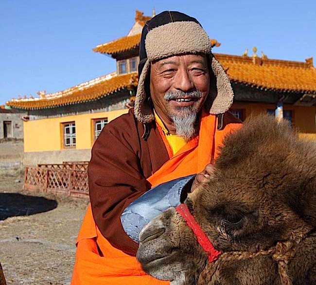 Rinpoche and friend during one of his remote missions to Mongolia. Rinpoche teaches in remote areas of Mongolia often only accessible by horse or four-wheel drive.