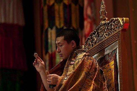 Buddha Weekly The 17th Gyalwa Karmapa Trinlay Thaye Dorje using bell and dorje during empowerment. Buddhism