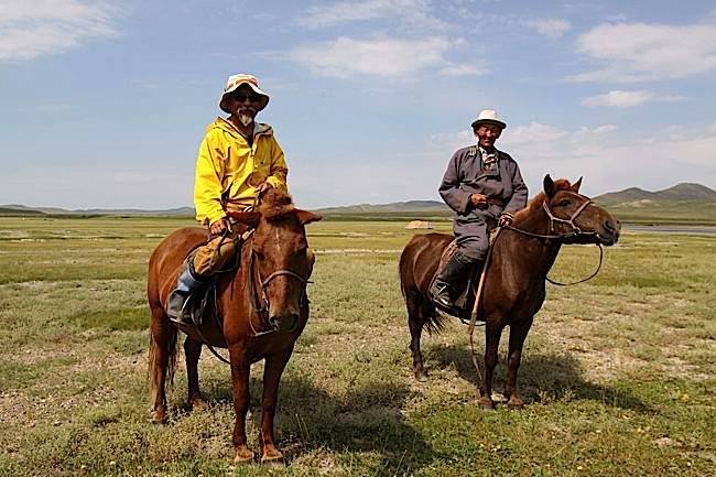Zasep Tulku Rinpoche (left) on a mission in Mongolia. Many areas in Mongolia are still only accessible by horse.
