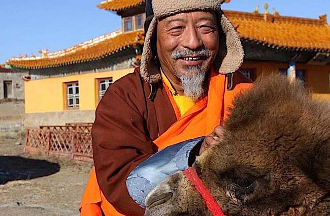 Rinpoche and a camel in Mongolia.