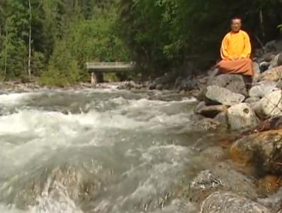 Zasep Tulku Rinpoche meditates by river Nelson BC