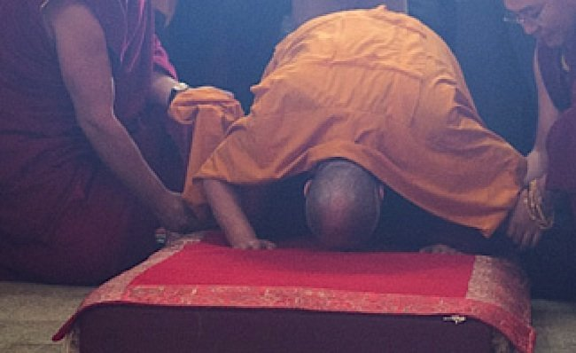 The Dalai Lama prostrates.