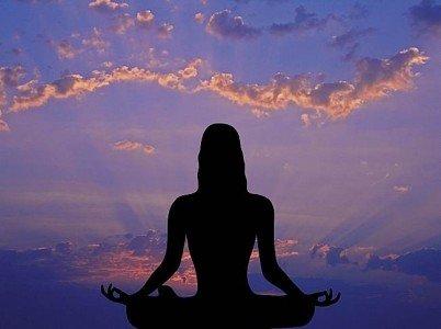Buddha Weekly Meditation against sunrise sky Buddhism