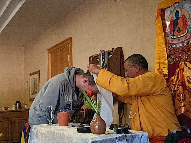 Rinpoche speaks with a student.