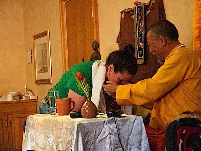 Zasep Tulku Rinpoche with a student.