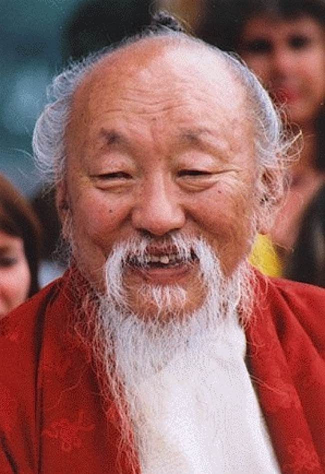 Lama Chagdud Tulku Rinpoche demonstrates happiness.