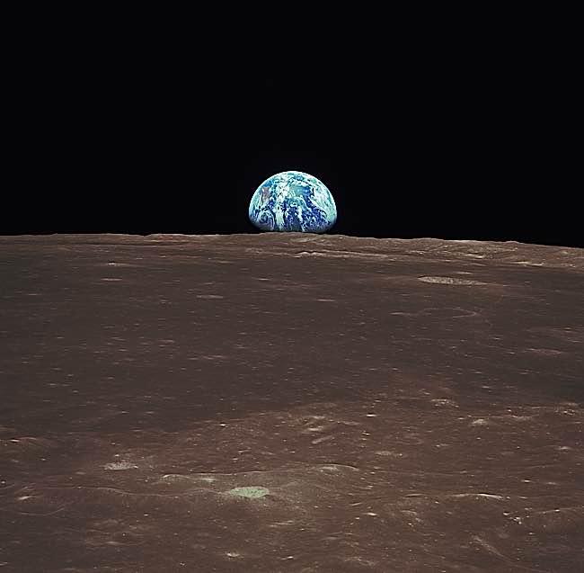 The earth also looks deceptively large rising above the horizon of the moon.