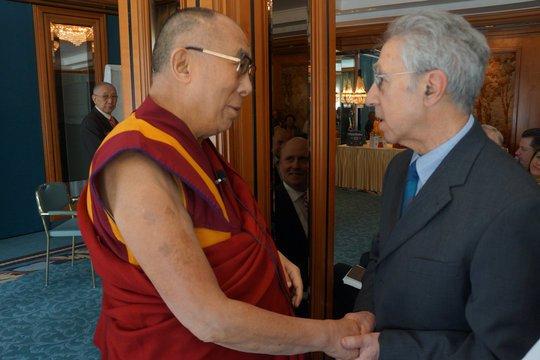 Alexander Berzin greets the Dalai Lama.