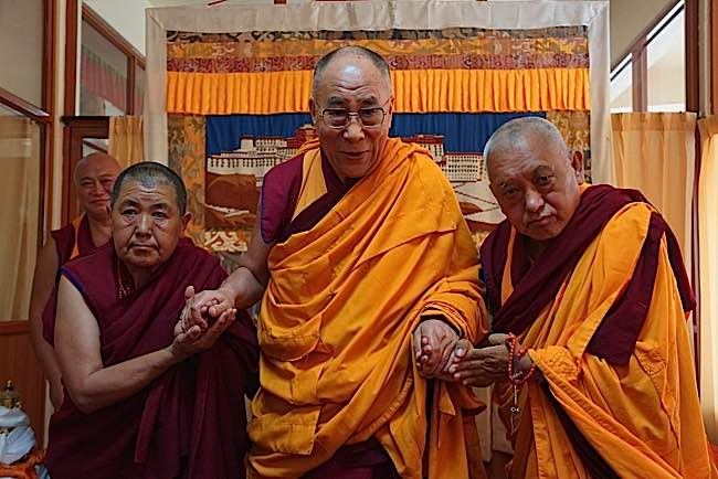 Teachers such as the Dalai Lama (centre) and Lama Zopa Rinpoche (right) teach compassion to non-humans and promote vegetarianism.