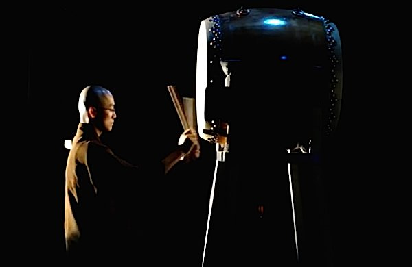 Monk on the big drum. This discipline is training for the mind.