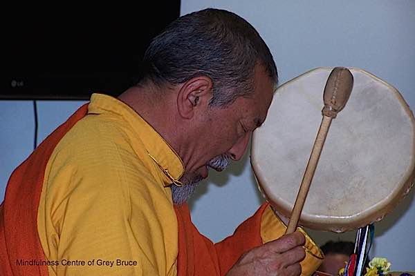 "In a nice surprise for the many attendees of a much-anticipated Mahamudra retreat, Venerable Zasep Tulku Rinpoche—an internationally respected Buddhist teacher—was joyously ""drummed in"" by people from the local native community. Kathy Hopson, who helped organize, explained: ""it is customary to Drum in an Elder or Healer out of Respect."" Zasep Rinpoche also teaches at Gaden Choling."