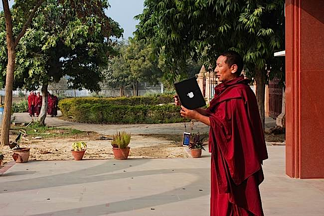 "Zasep Rinpoche, during an interview, said: ""Even some monks, now, instead of holding malas and doing mantras, they have their phones in hand, sending messages, text messages."" Above: monk with Ipad."