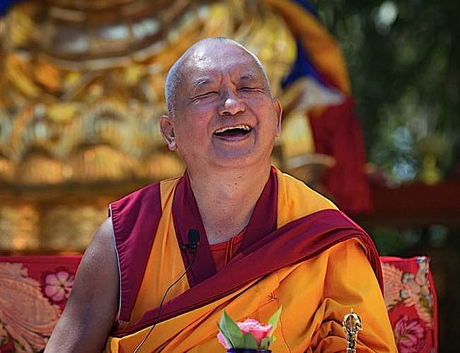 Monks and Buddhist teachers tend to laugh or smile frequently. Lama Zopa Rinpoche laughing.