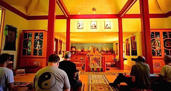 Formal retreats with a teacher can take many forms, such as teaching retreats, mantra retreats and other extensive retreats. Although nothing can replace this experience, some busy lay practitioners can emulate the experience with intensive home retreats. Photo: Retreat at Tashi Choling retreat center, Nelson BC with teacher Zasep Rinpoche.