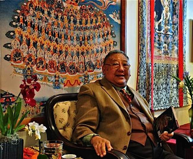 "Gelek Rimpoche of Jewel Heart teaching in front of a ""Tree of Refuge"" tangkha."