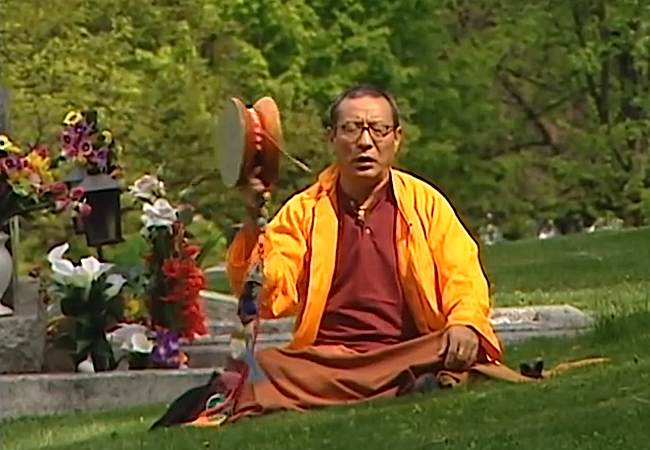 """Venerable Zasep Tulku Rinpoche practicing Chod in a cemetery — from the movie """"Come Again."""" """"The Chod practice dispels negative mental states, which are our """"demons."""" The Chod practice transforms mental defilement into the wisdom of Bodhichitta and Shunyata."""" — from an description of an Chod initiation event and teaching from Zasep Tulku Rinpoche, December 1, 2016 at Gaden Choling in Toronto."""