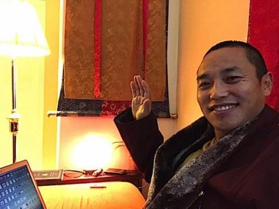 Buddha Weekly Chaphur RInpoche working on computer Buddhism
