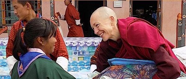 Buddha Weekly Emma Slade Buddhist Nun with Child in Bhutan Buddhism
