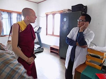 Buddha Weekly Emma Slade in Phsyio Clinic Working on Opening Your Heart to Bhutan Charity Buddhism