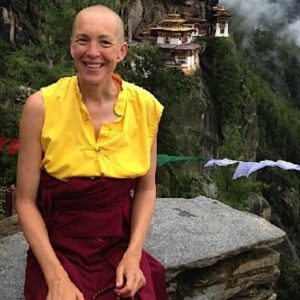 Buddha Weekly Emma Slade in front of temple mountains Buddhism