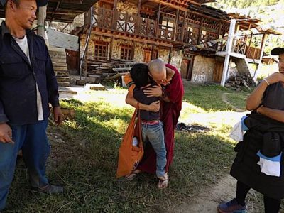 Buddha Weekly Emma Slade with Child Opening Your Heart to Bhutan Charity Buddhism
