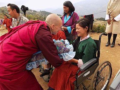Buddha Weekly Emma Slade with children Opening Your Heart to Bhutan Charity Buddhism