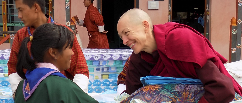 Emma Slade Buddhist Nun with Child in Bhutan