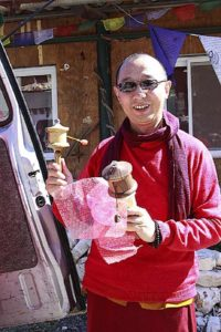 Buddha Weekly Abou Lama with a new prayer wheel from Galgamani Art Project Buddhism