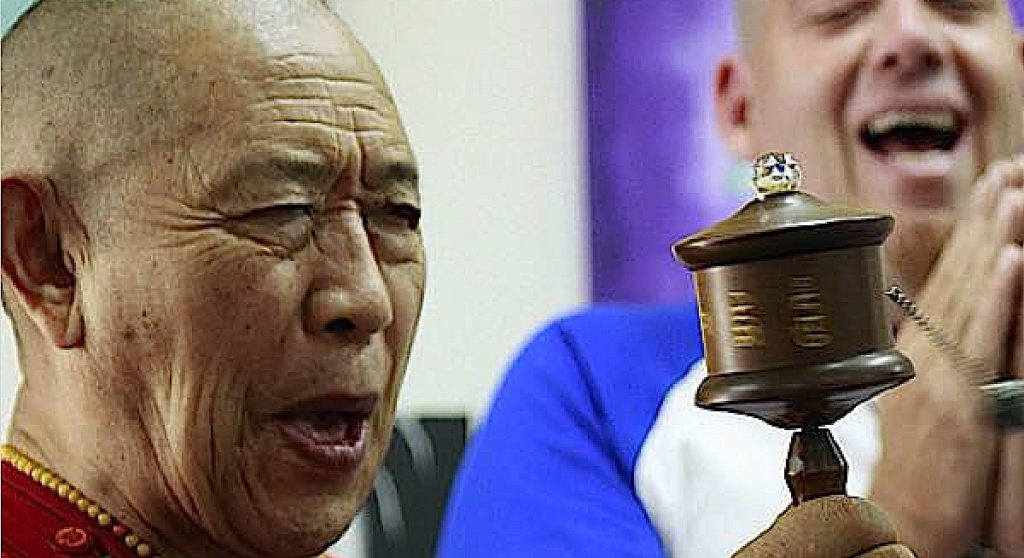 H.E. Garchen RInpoche with Micha Strauss of Galgamani Art Project and a custom made prayer wheel.