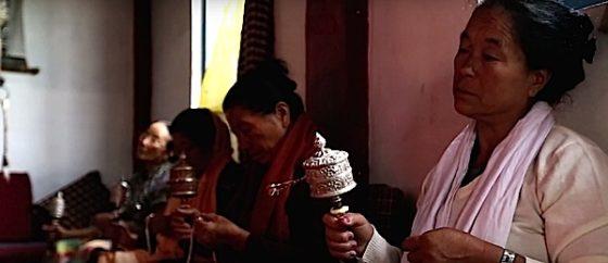 Buddha Weekly Ladies spin prayer wheels at monestary in sikkhm Buddhism