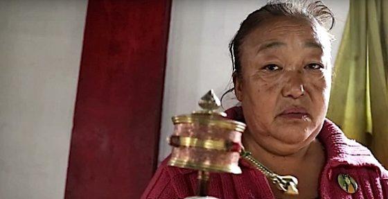 Buddha Weekly Lady spins prayer wheel Buddhism