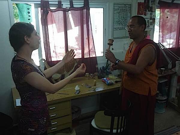 Buddha Weekly Lama Tenzin tries prayer wheel at Galgamani Buddhism