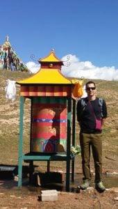 Buddha Weekly Shea Witsett of The Prayer Wheel Shop at a water prayer wheel Buddhism