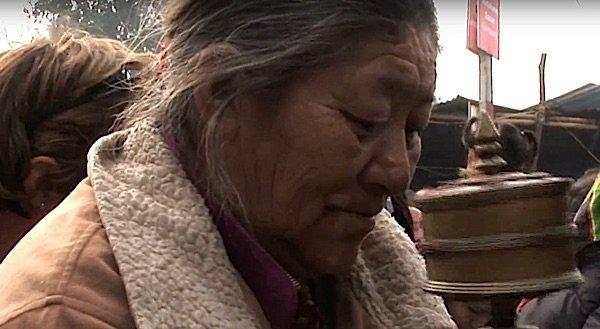 Buddha Weekly Tibetan Man with Prayer Wheel in Bodhgaya Buddhism