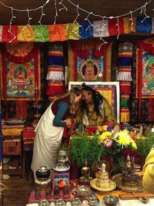 Buddha Weekly Lama Dr. Shannon Young teaching greets her teacher Dzogchen Khenpo Choga Rinpoche Buddhism