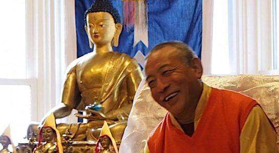 Buddha Weekly Zasep Tulku Rinpoche laughing at Gaden Choling in front of altar Buddhism
