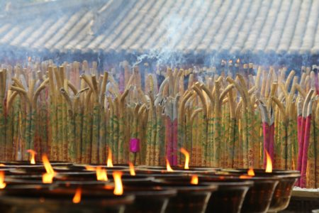 light and incense candles and joss sticks at Buddhist temple