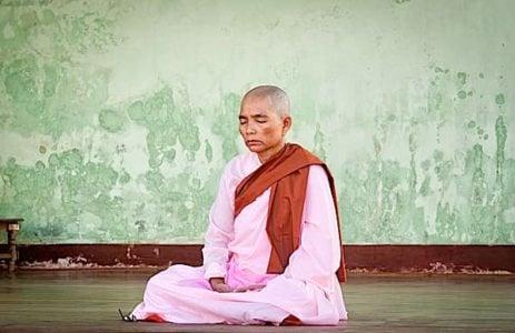 Buddha Weekly Buddhist nun meditating during full moon festival Shwedagon Pagoda 2010 Myamar Buddhism