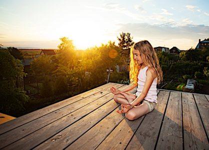 Buddha Weekly Child meditating at sunrise Buddhism