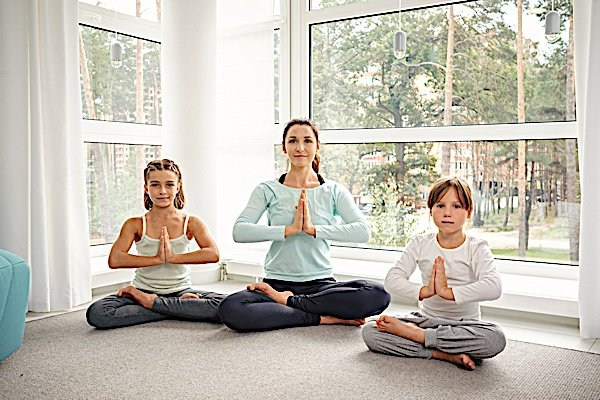 Buddha Weekly Children and mother meditate together Buddhism