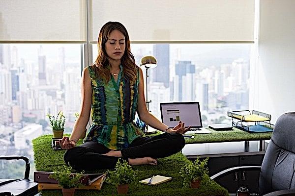 Buddha Weekly Business woman meditating Buddhism