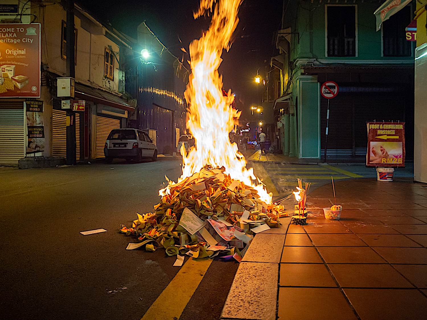 """During Ghost month, or Ghost Day, it is traditional in many parts of Asia to burn """"paper money"""" and other offerings for the ghosts, to relieve their suffering."""