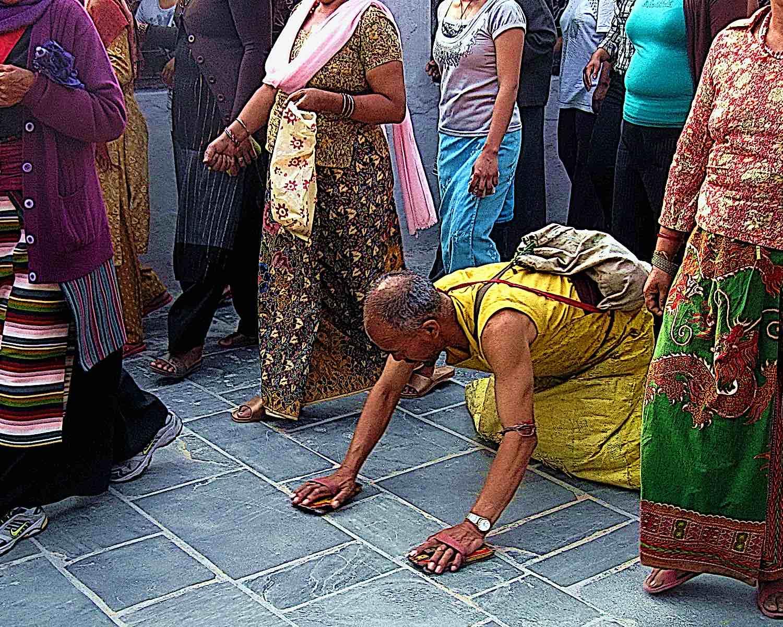 Buddha Weekly Buddhist Prostrations and circumambulation of Stupa in Katmandu Nepal Buddhism